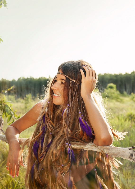 Fashion portrait of beautiful hippie young woman outdoors. bohemian style